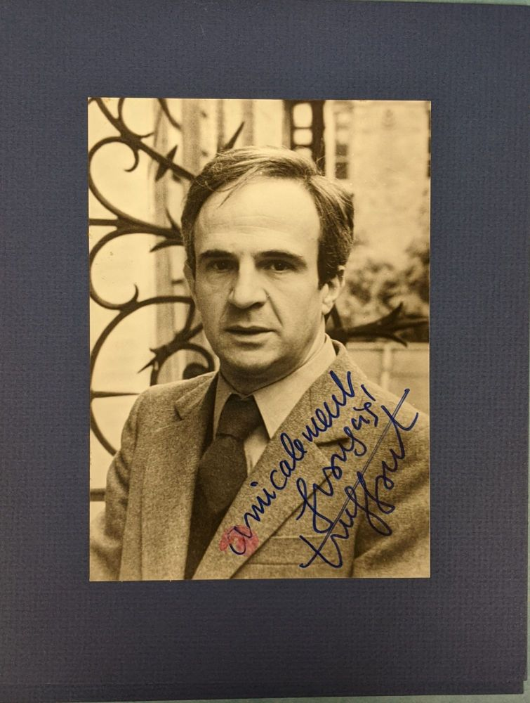 """Signed photograph of Francois Truffaut, with additional shots from """"Don't Shoot the Piano Player,"""" and """"The Wild Child"""" Francois Truffaut."""